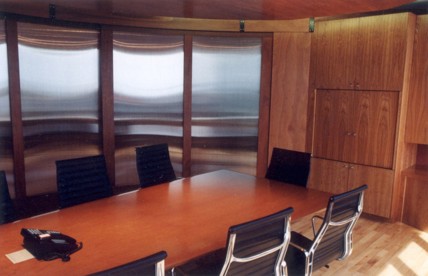 Office meeting room with custom cabinetry and wall panels, with sliding doors for privacy