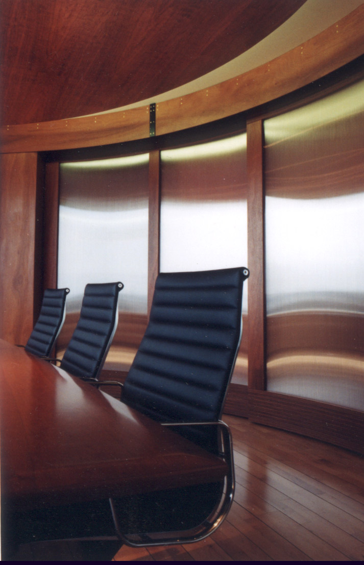 Toronto office meeting room with custom mahogany curved sliding doors with reflective panels