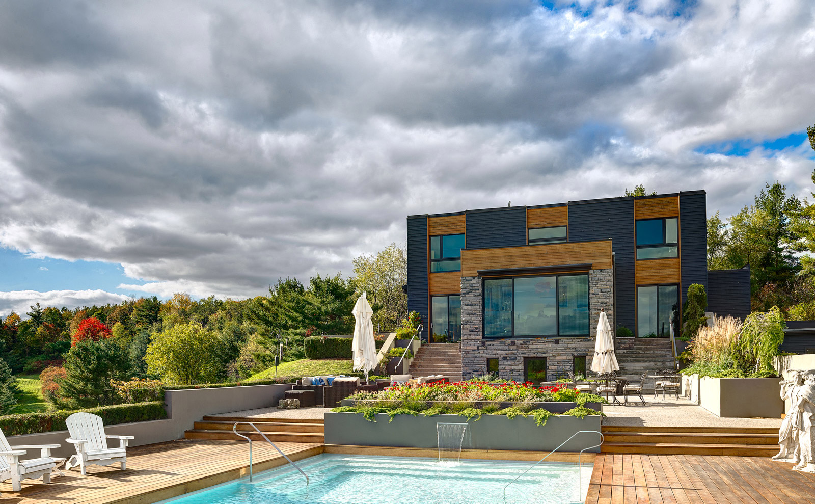 King City House landscaped exterior with pool and Ipe decking