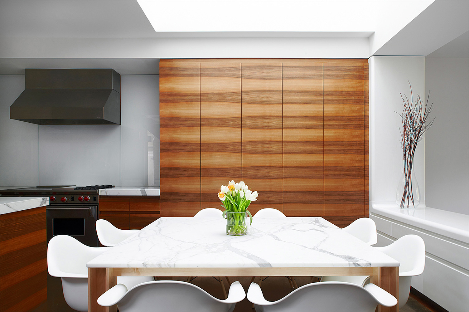 Contemporary dining room with floor-to-ceiling French Walnut cabinetry