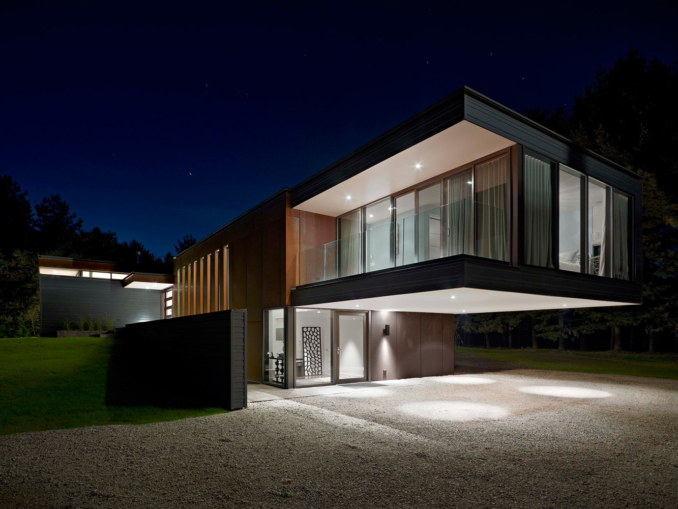 Contemporary Collingwood home with Self-Weathering Steel Corten siding and large Master bedroom cantilever