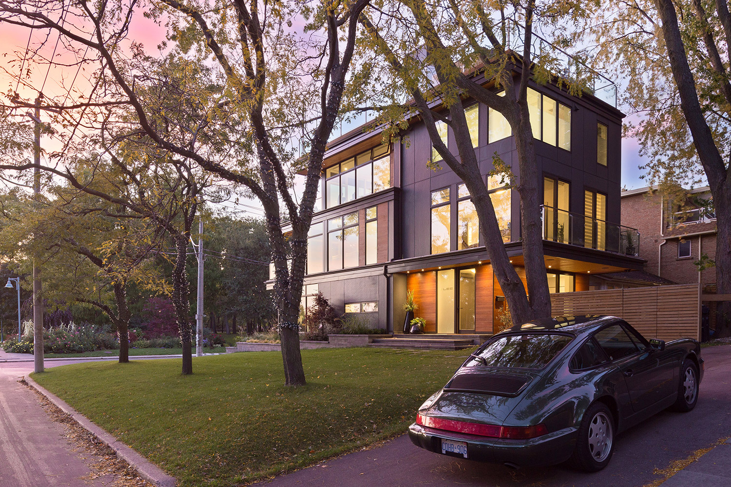 Contemporary Toronto Beaches home with fir and Hardiboard siding