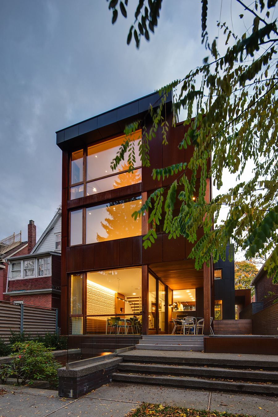 Toronto Roncevalles home with Contemporary self-weathering steel facade