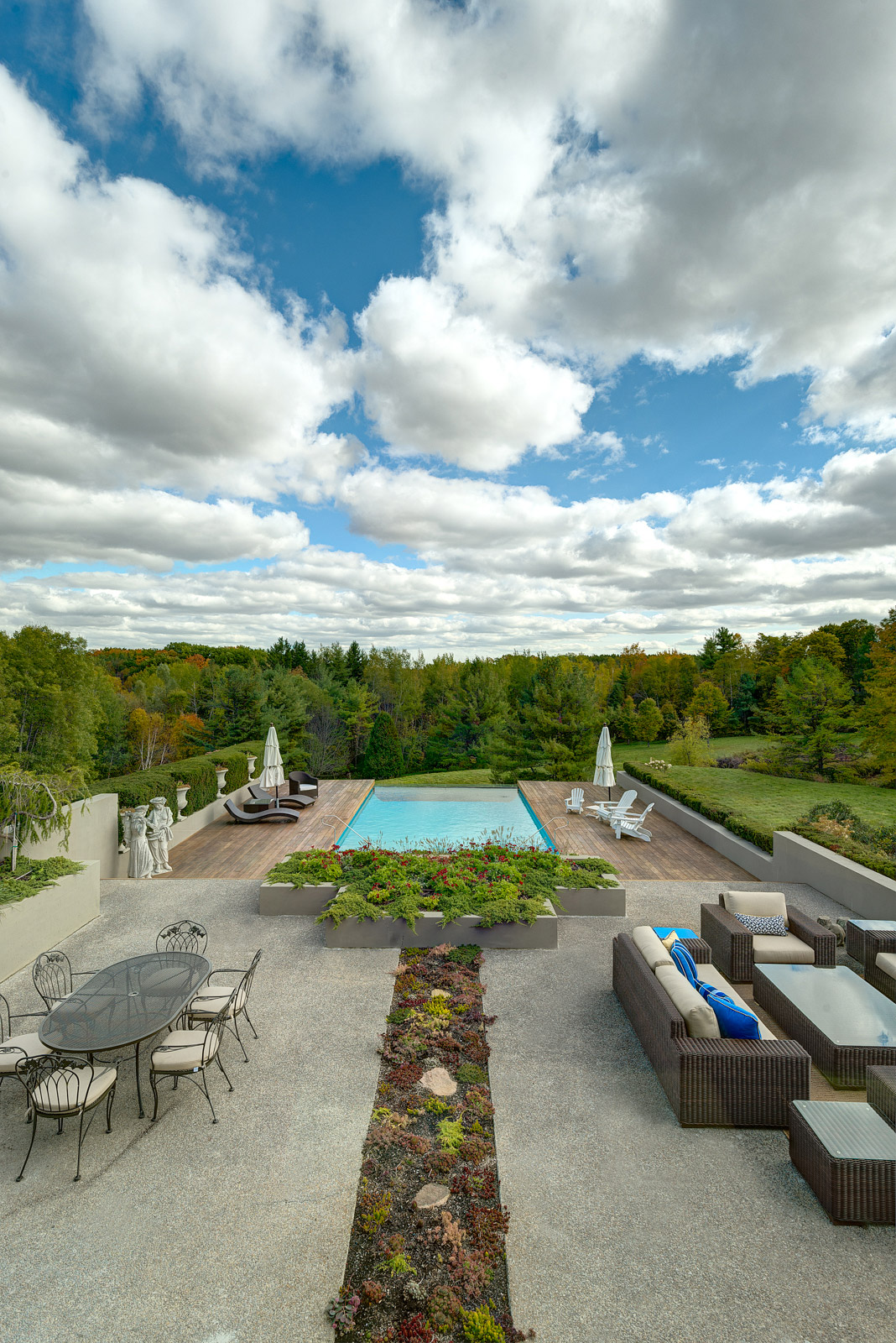 Toronto area home with naturalized local landscaping and large deck area with seating and dining.  Kebony pool deck