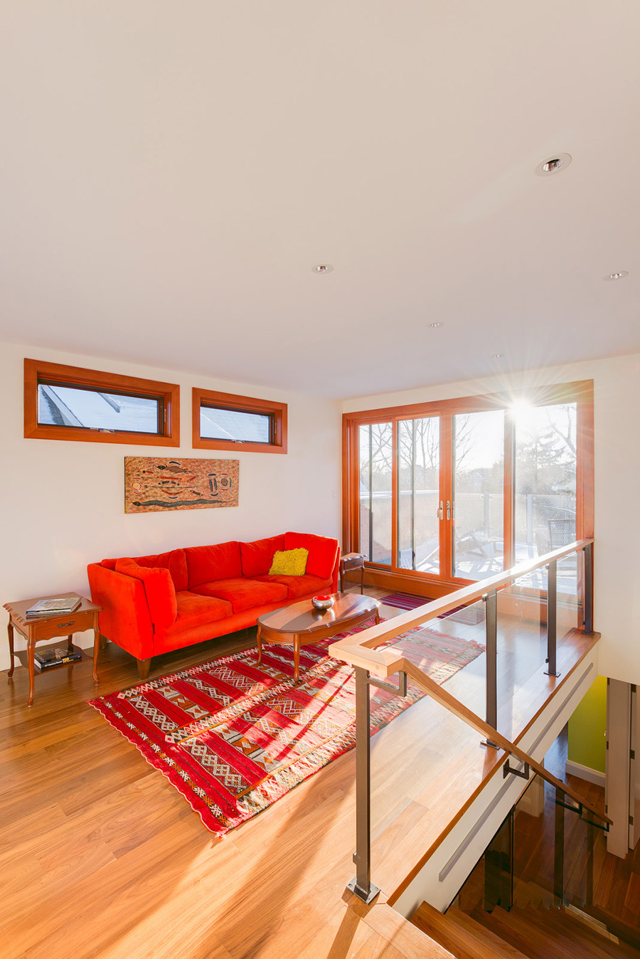 Siting room with open stair and large sliding doors to access rooftop balcony