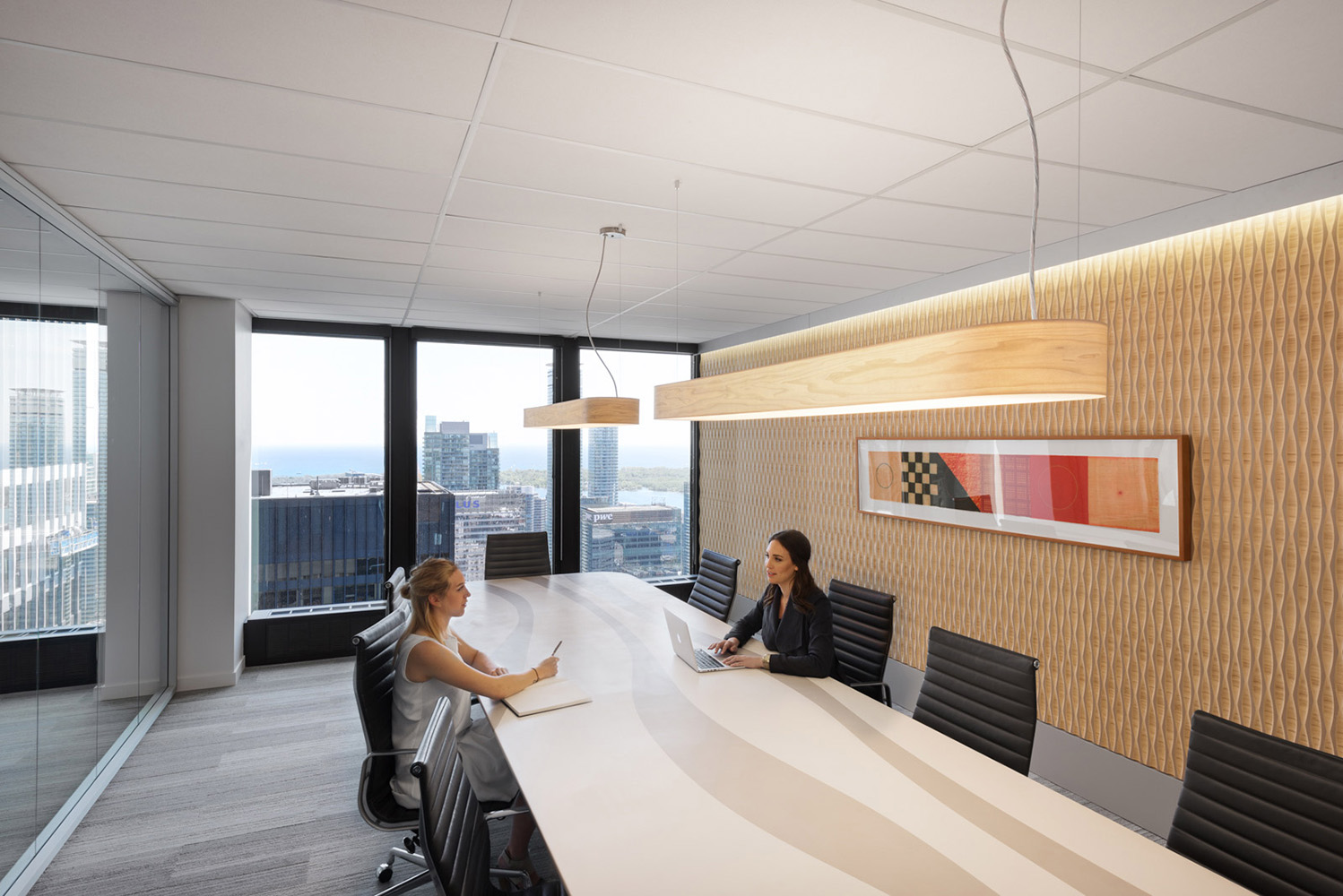 Toronto TD tower office meeting room with wood veneer hanging lights and textured accent wall