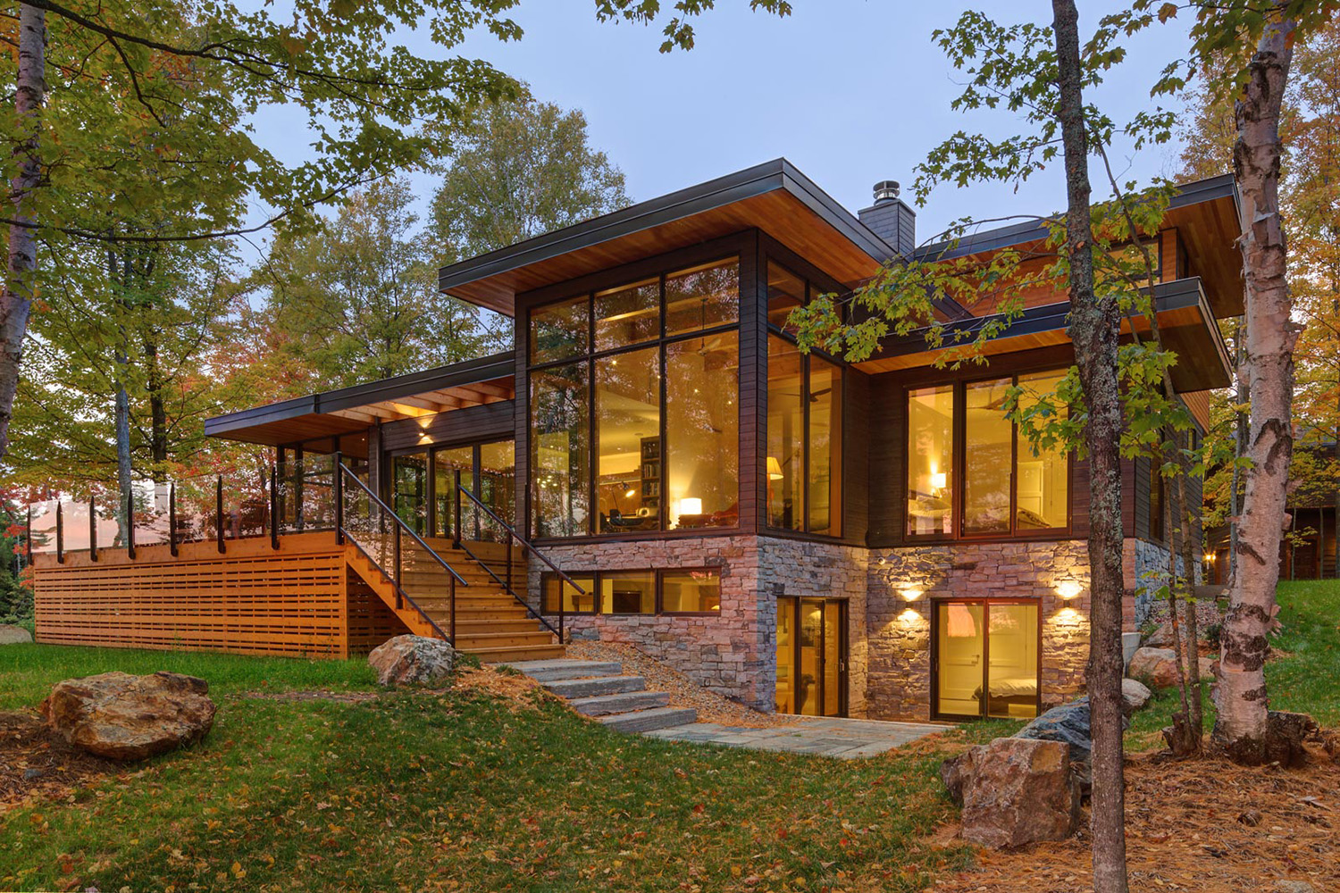 Contemporary Kawartha's cottage to Douglas fir overhangs, Maibec siding, stone siding and large floor to ceiling windows