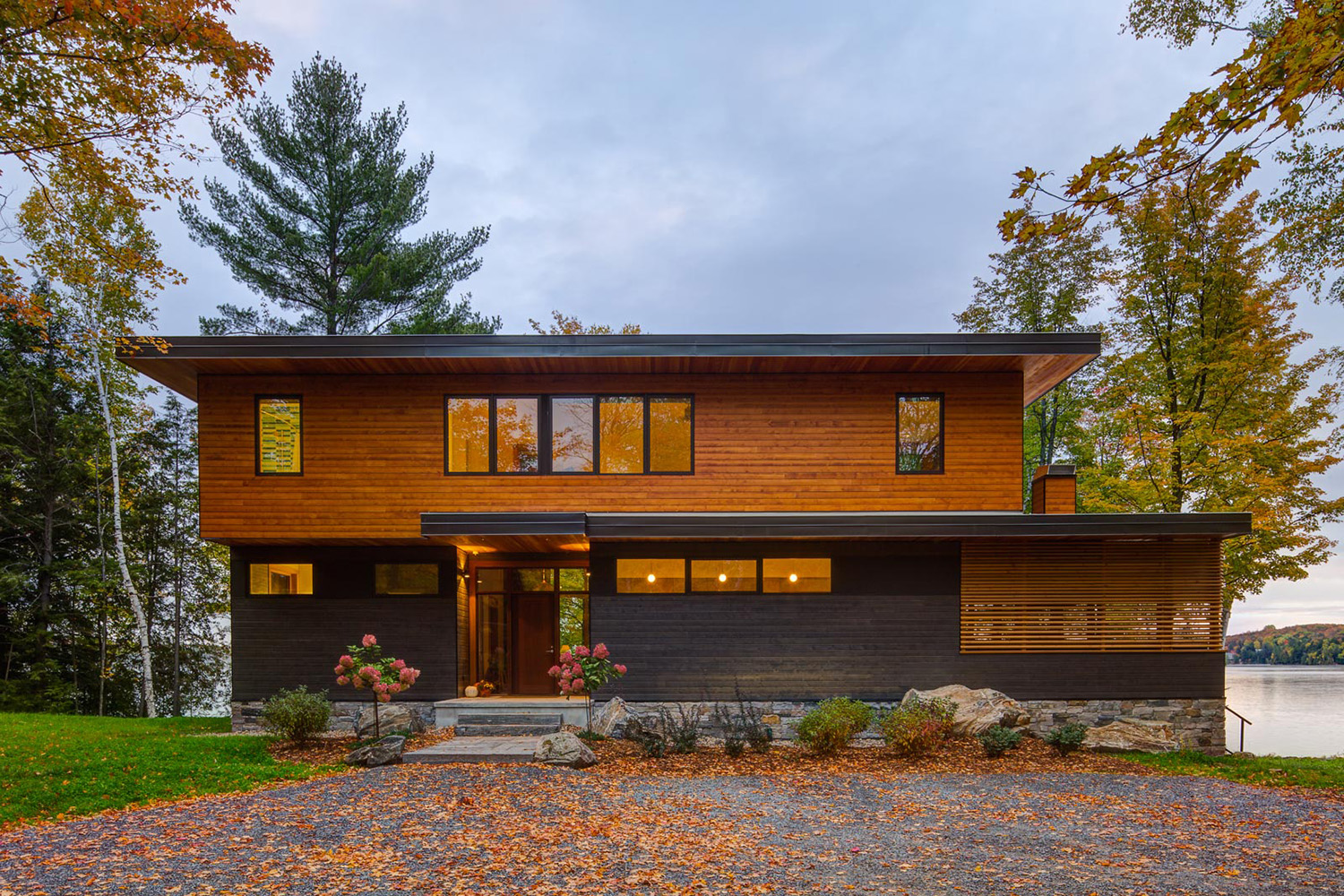 Contemporary Canadian cottage with dark gray and natural coloured Maibec wood siding