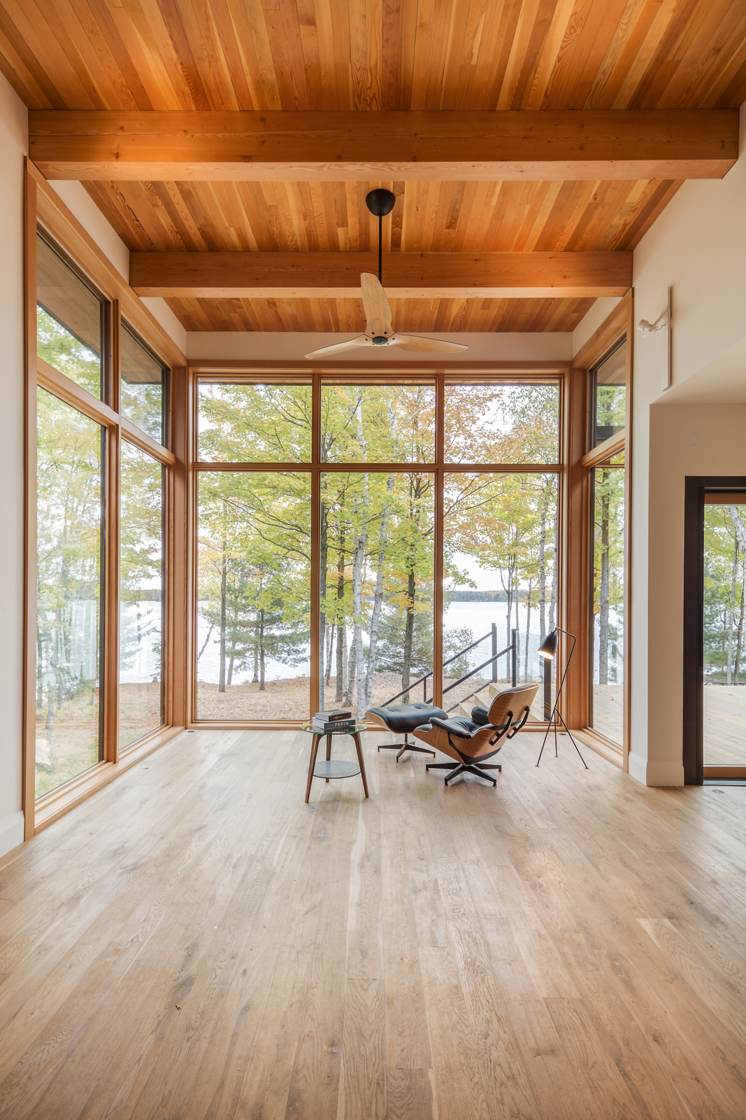 Ontario cottage reading nook with Douglas fir timber roof structure and planking, with large floor-to-ceiling windows