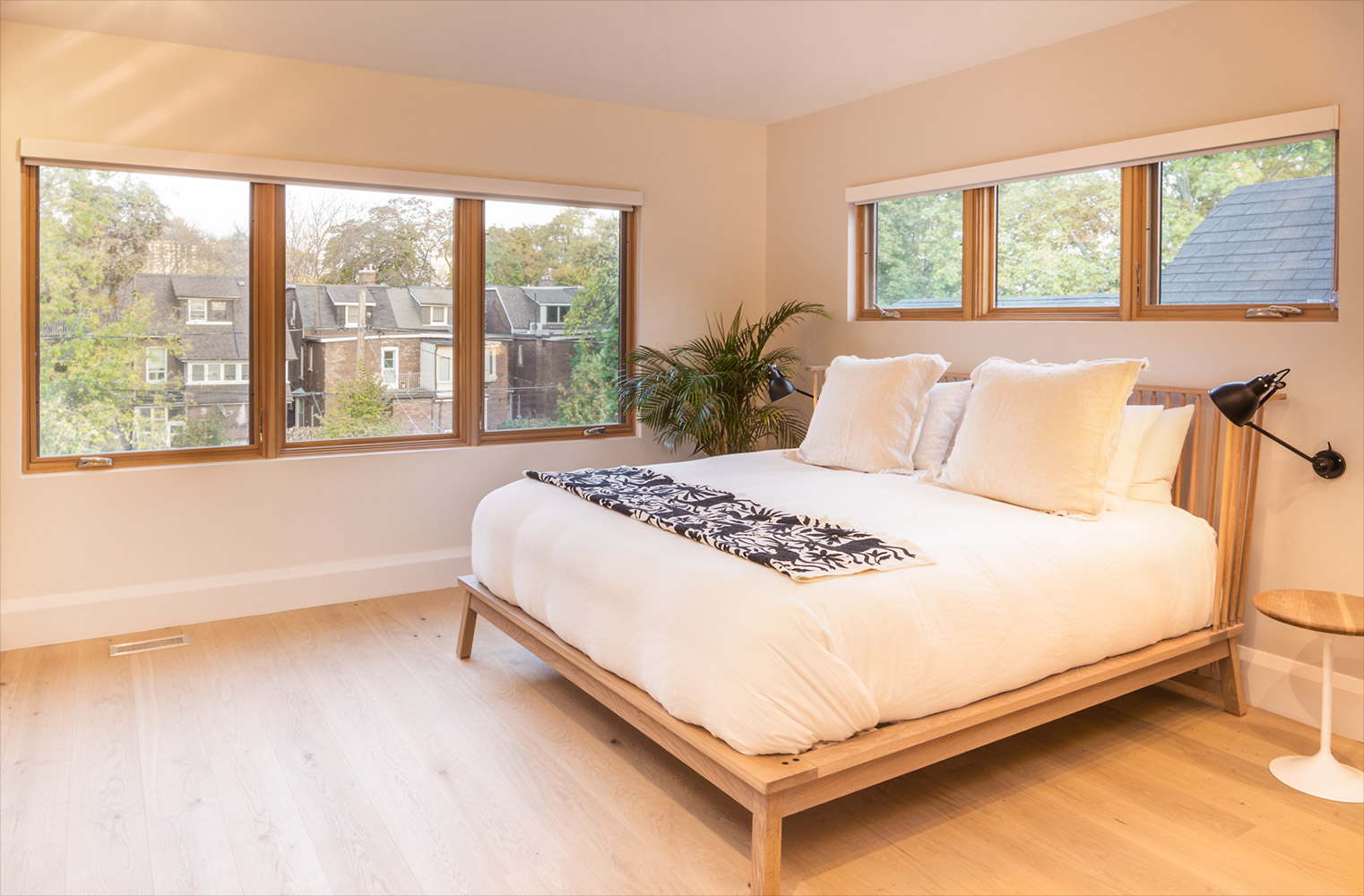 Master bedroom with white oak ribbon windows and custom made white oak bed frame and floors