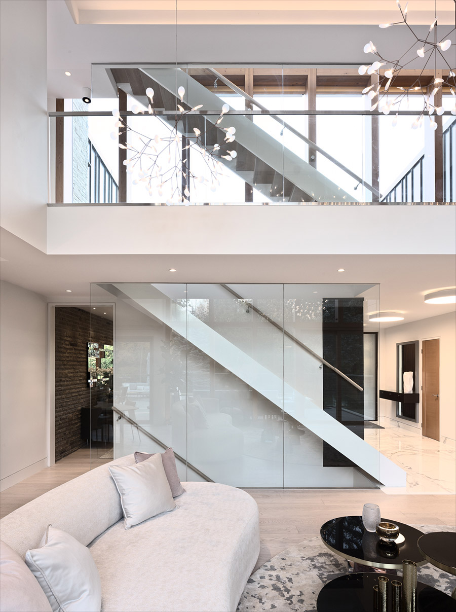 Open stairway and second floor with marble and wide plank wood floor