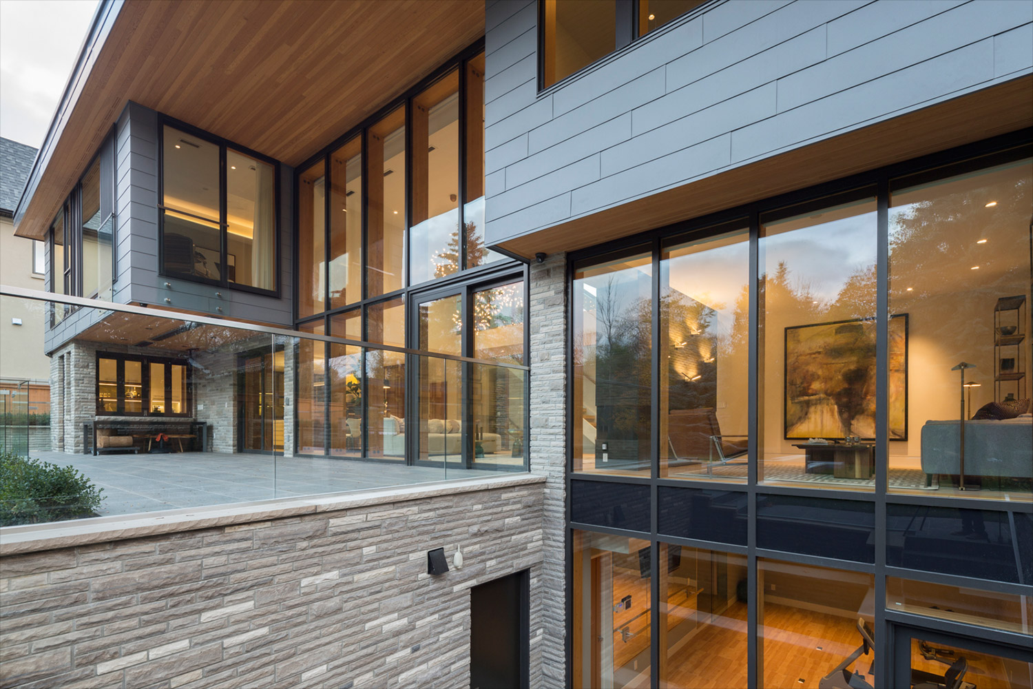 Basement walkout with Ledgerock veneer stone, Douglas fir soffits, Zinc siding