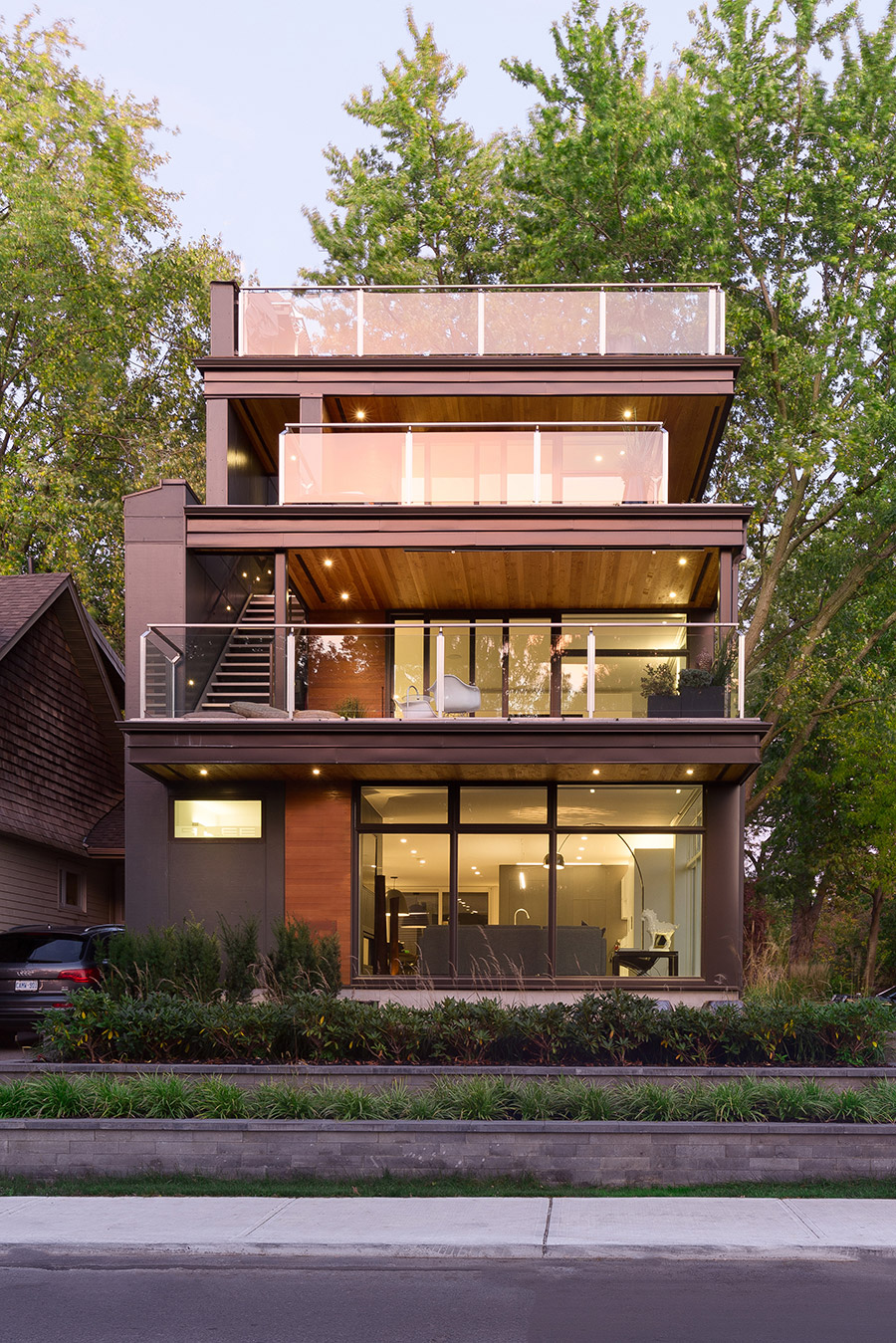 Toronto Beaches modern home with multiple balconies and large floor-to-ceiling windows