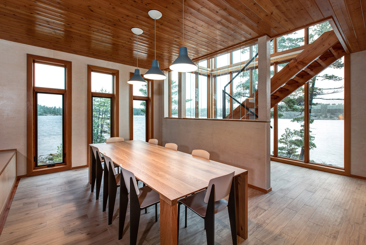 Modern cottage dining room with modern harvest dining table and hanging pendant lighting