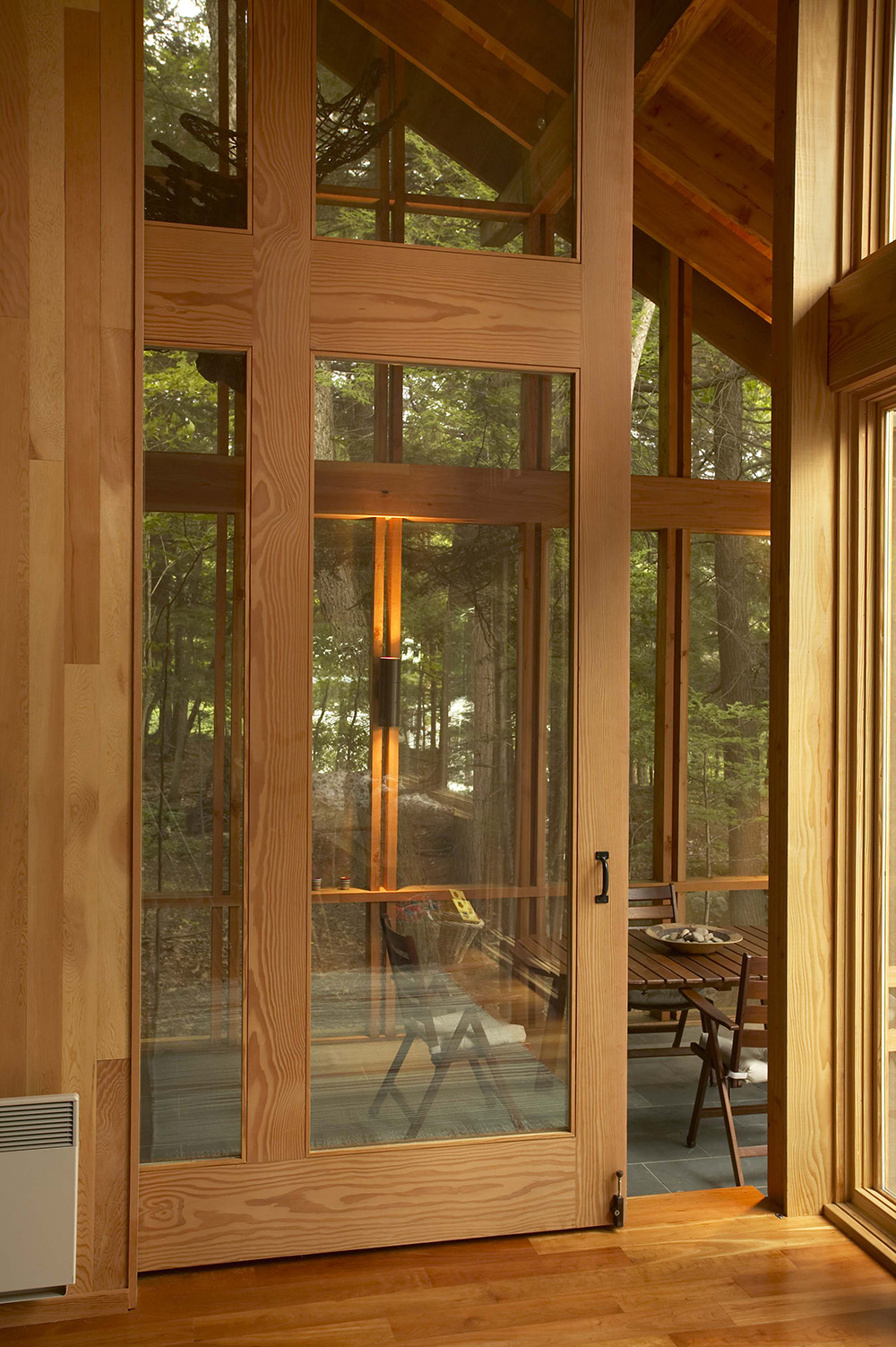 Large Douglas Fir and glass sliding pocket door to screen porch, closed