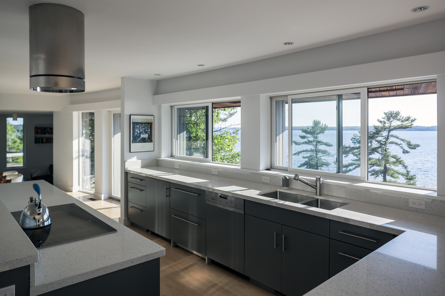 Parry Sound cottage with views to the Georgian Bay with quartz countertops and gray cabinetry