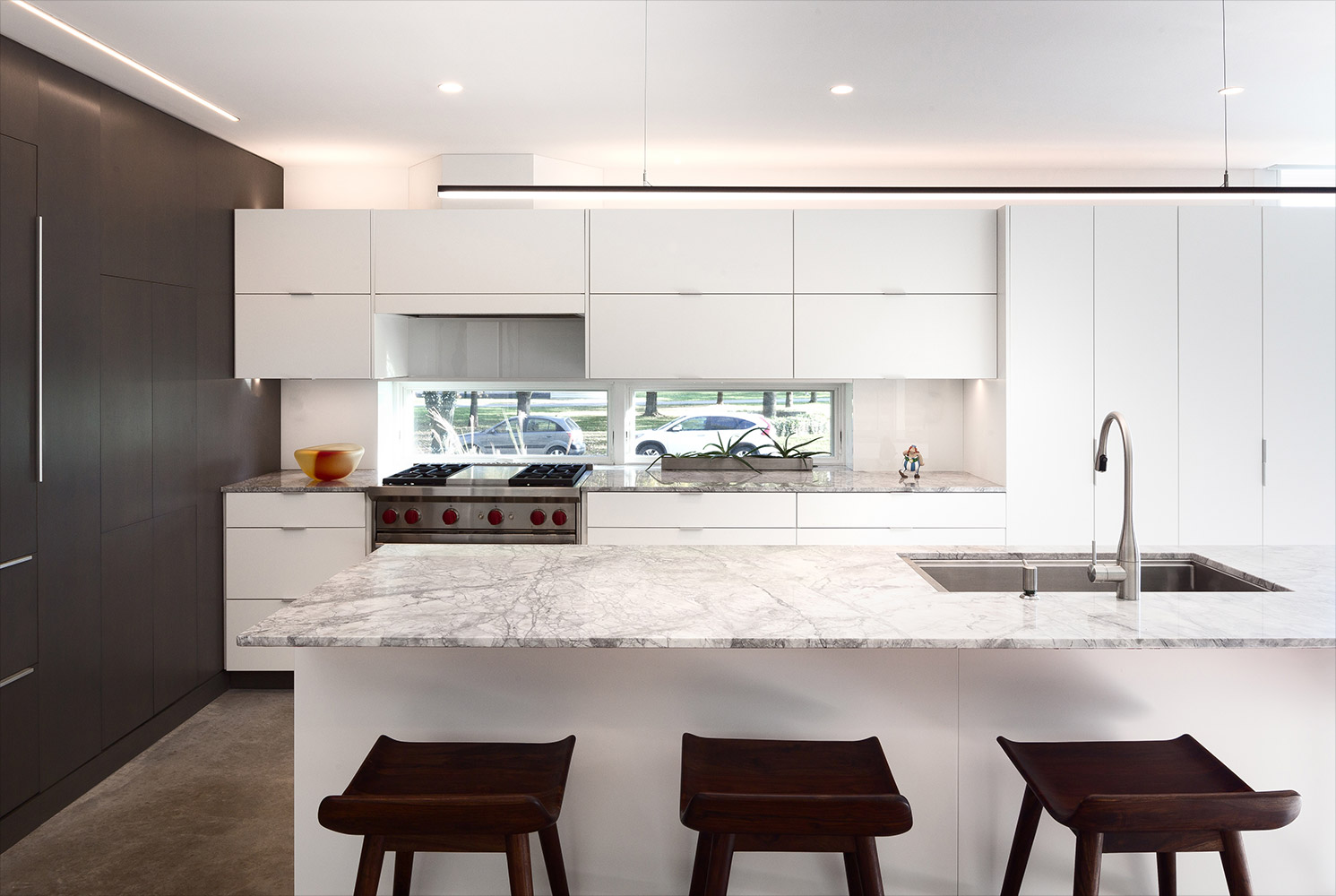 Kitchen with marble countertops undermounted sink, gas range with hidden vent hood, and gray oak cabinetry