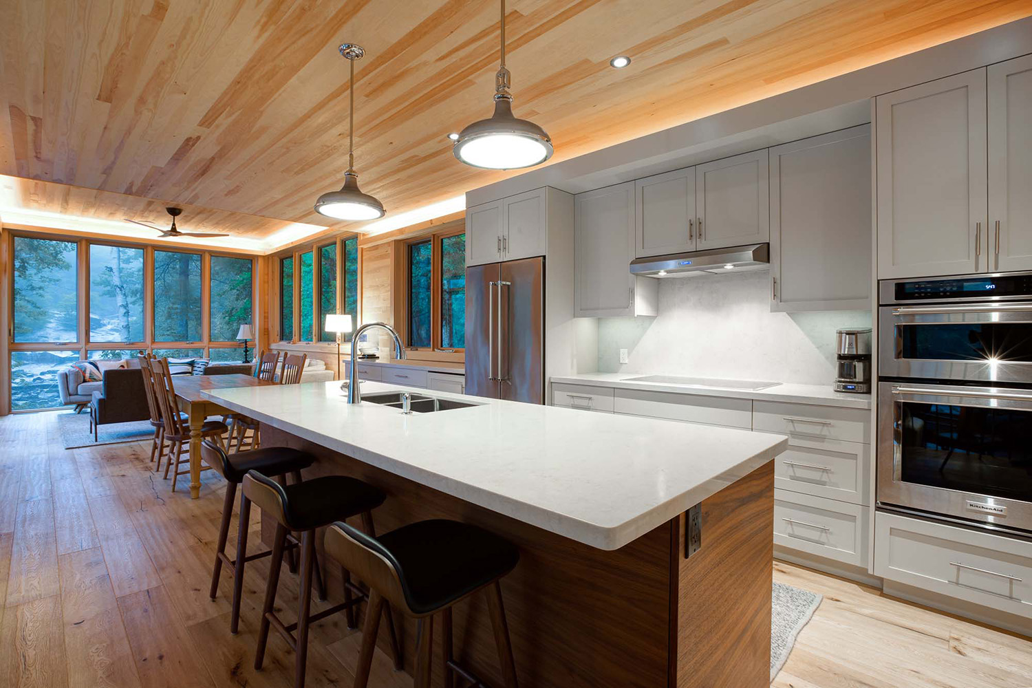 Contemporary custom kitchen with walnut island and gray painted shaker cabinetry