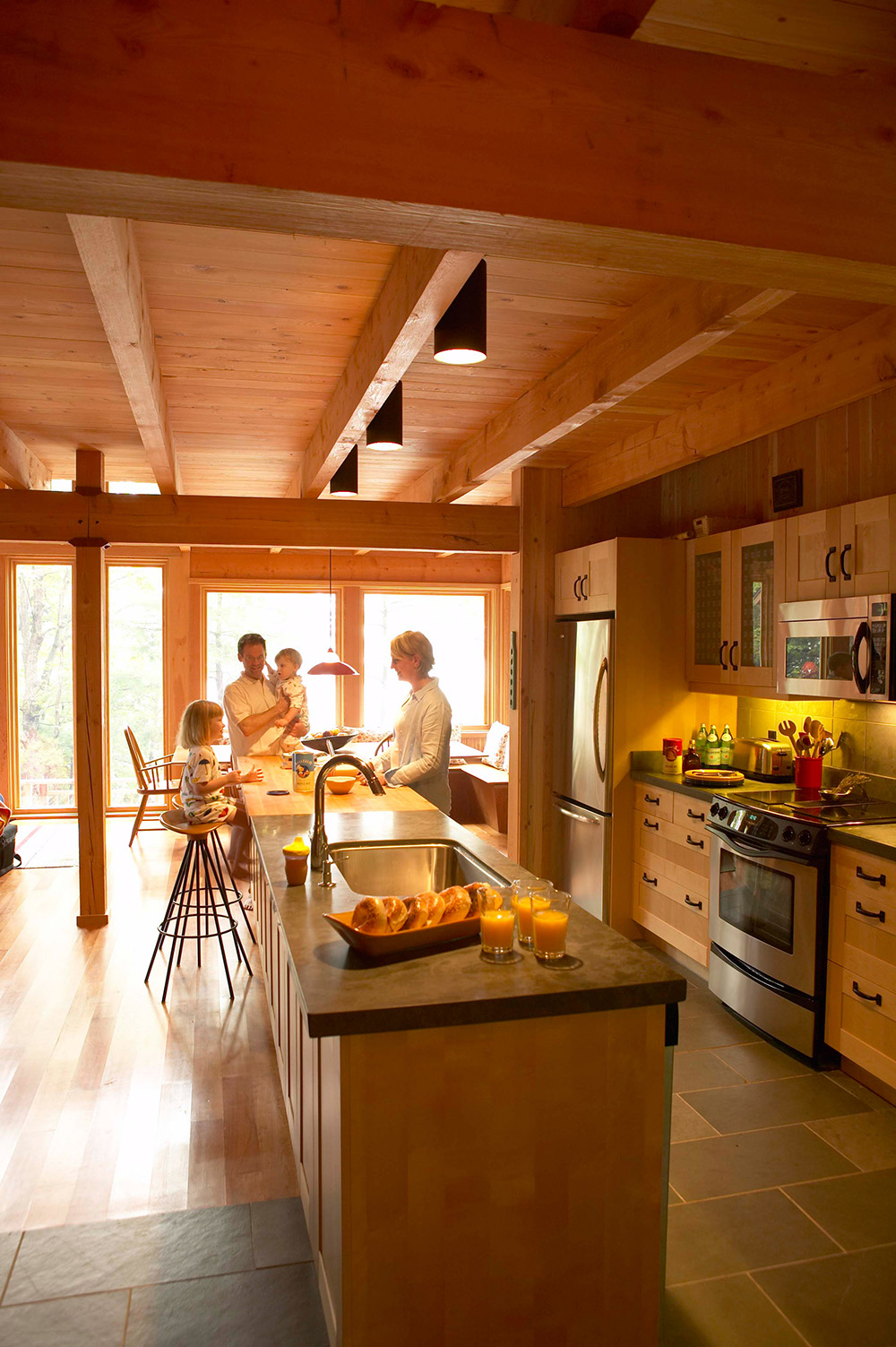 Timber-framed kitchen with slate and butcher-block countertops