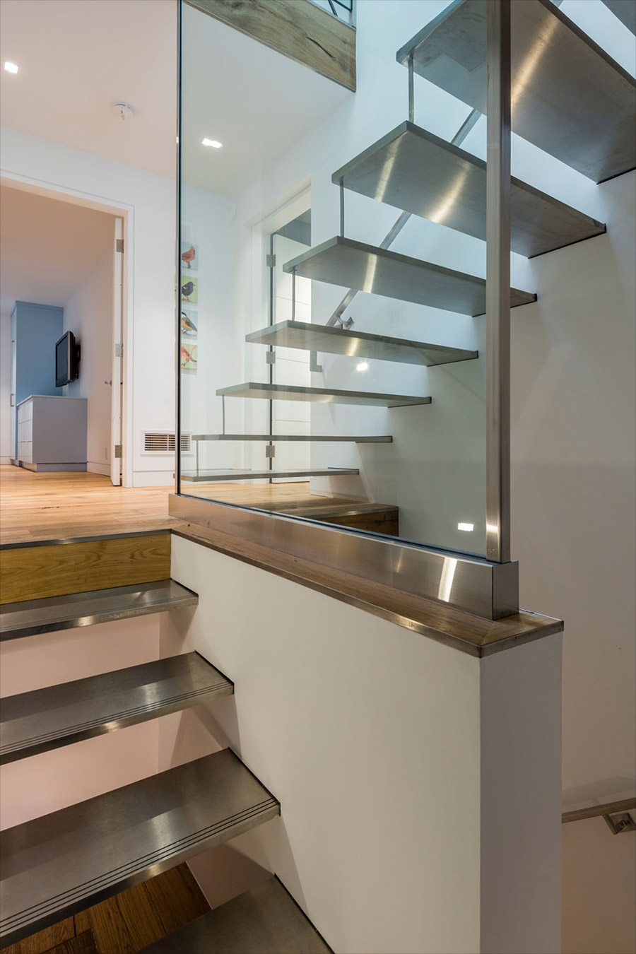 Open riser stainless steel stair with tempered glass guard