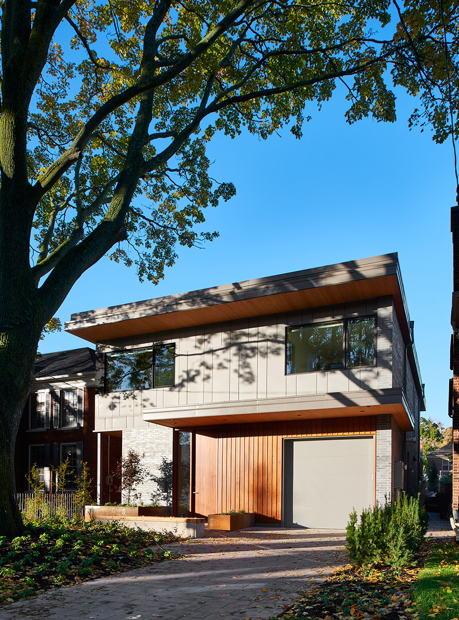 Contemporary Toronto Leaside home with zinc and wood siding  and integral garage