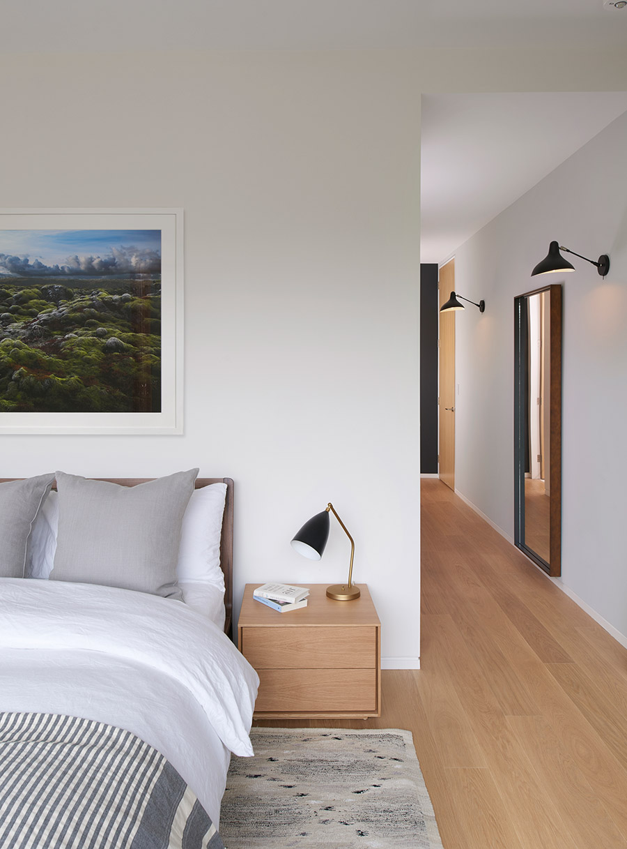 Master bedroom trimless walls and wide plank oak flooring. Toronto architect Designlines magazine interior design.