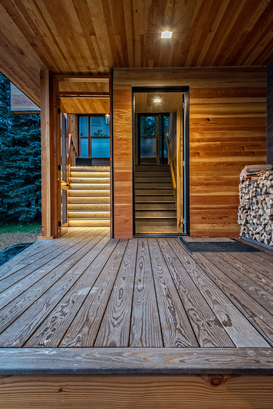 Cottage entrance with firewood storage Kebony decking colour matched poplar siding