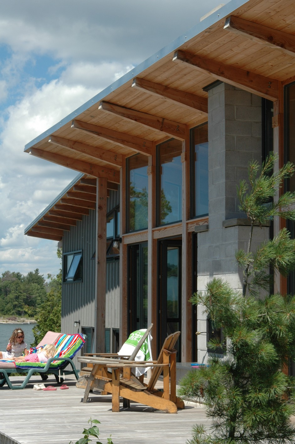 Ontario cottage with big Douglas Fir overhangs to create passive solar shading