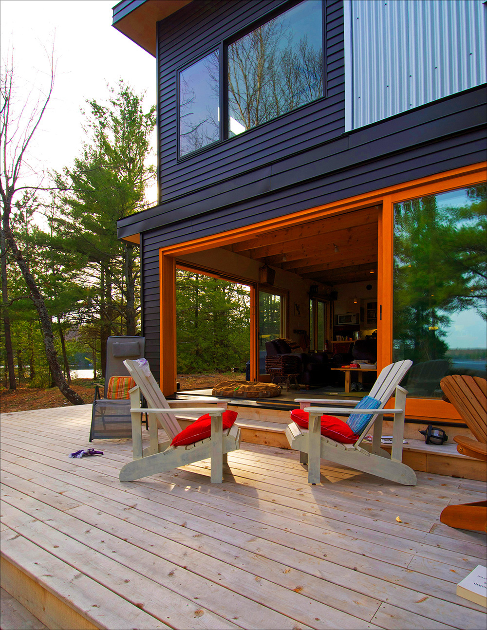 Cottage deck with large sliding door opening into the cottage interior