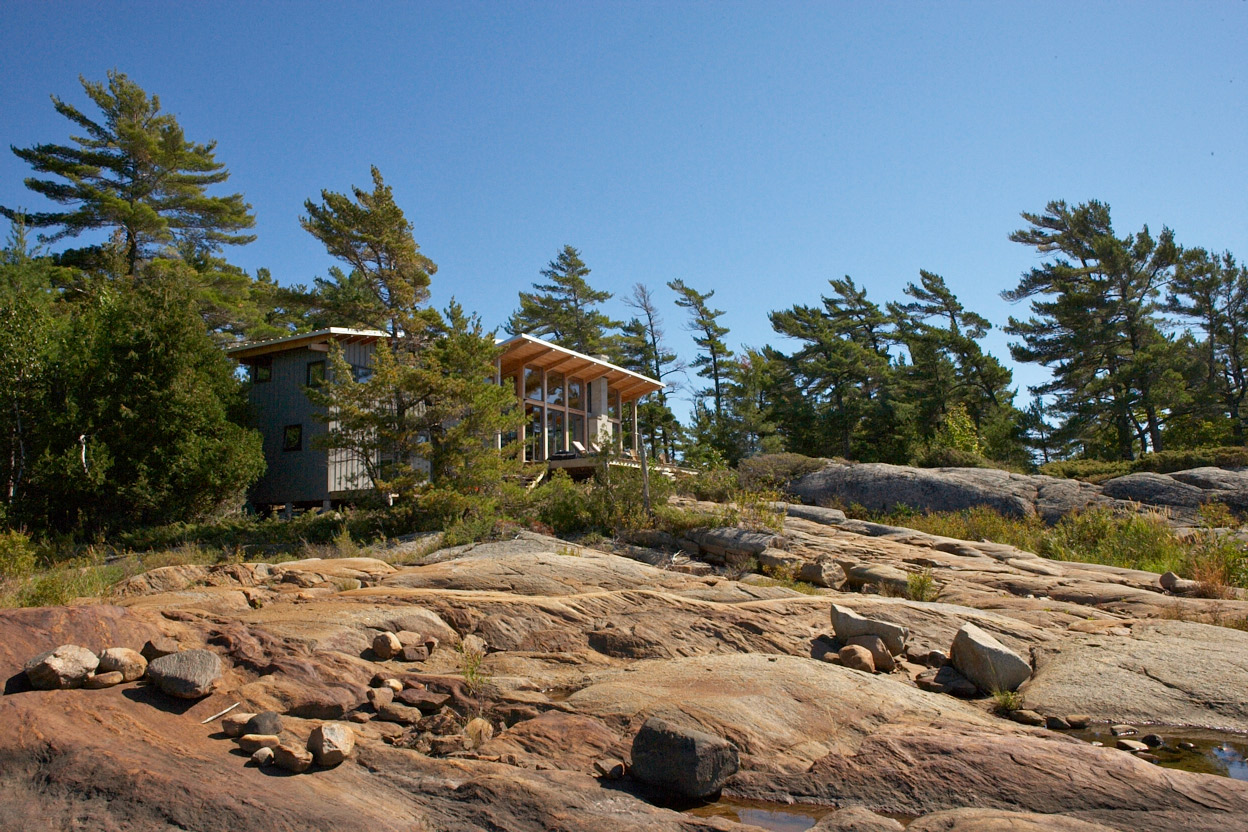 Natural Georgian Bay landscape with cottage integrated into local pine trees