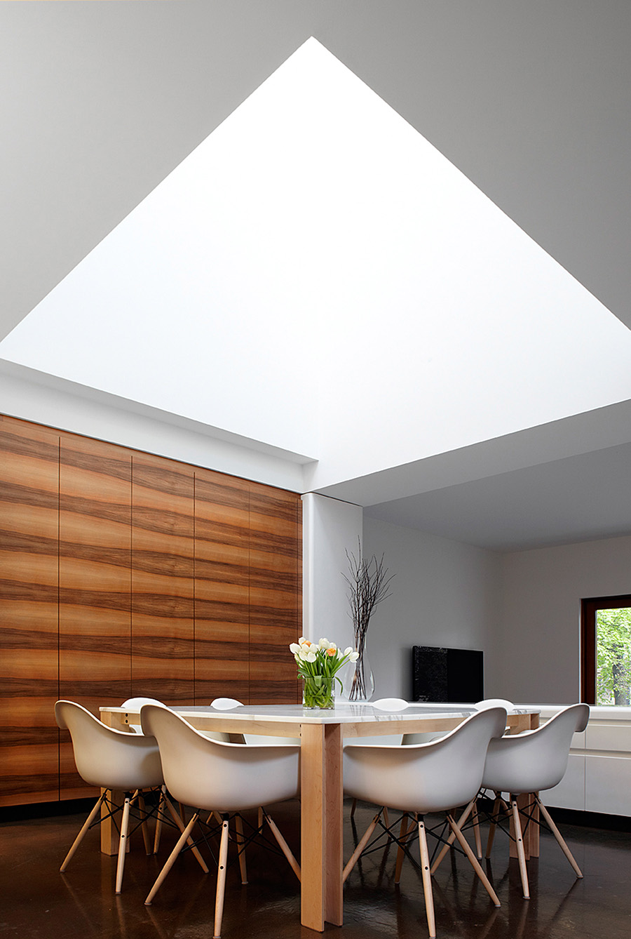 Dining Room with large skylight above custom marble and wood dining room table