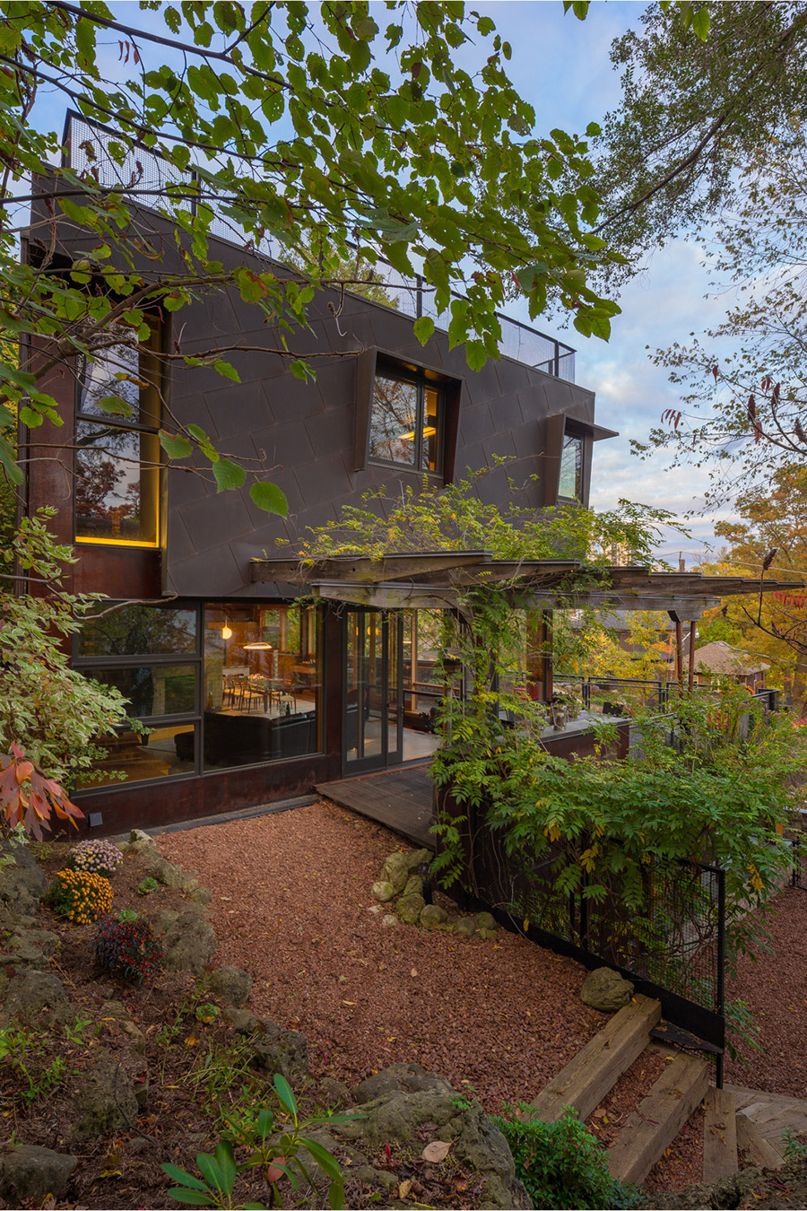 Modern home with Corten steel siding integrated into surroundings