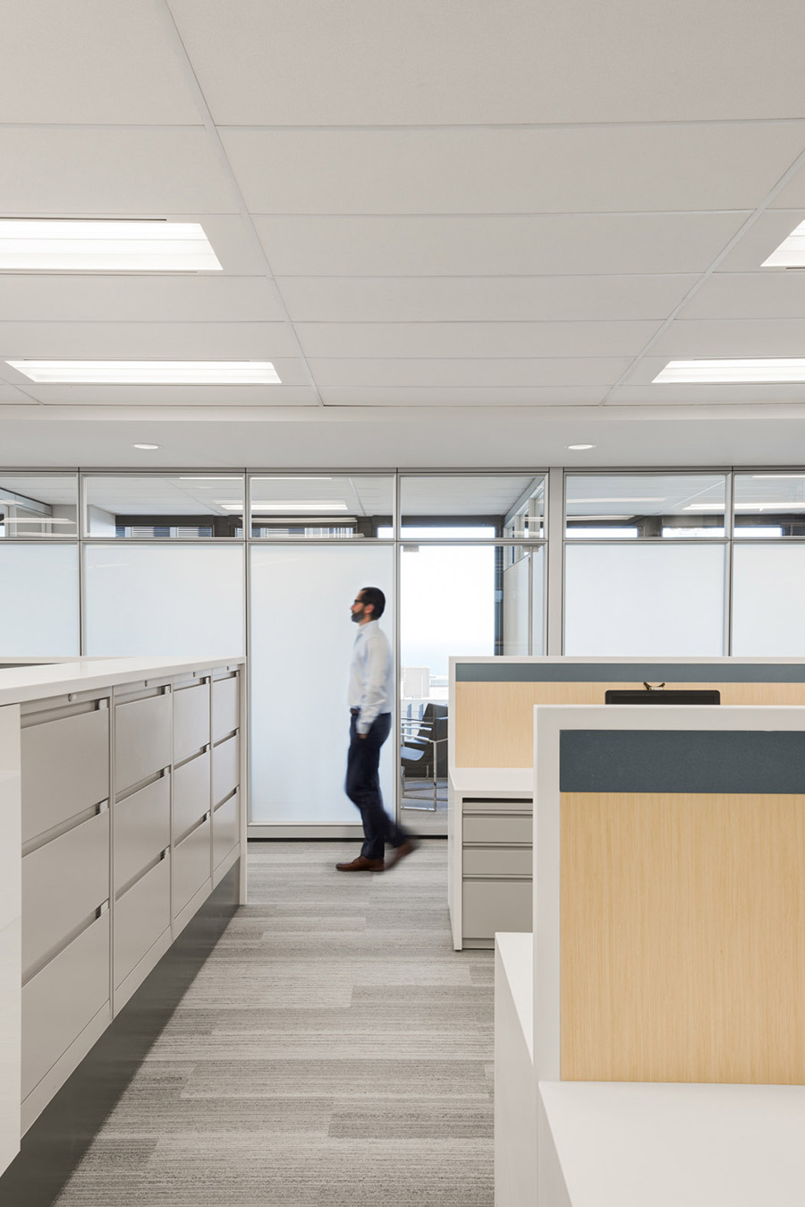 Built in Office filing cabinets and desks with wood backsplashes