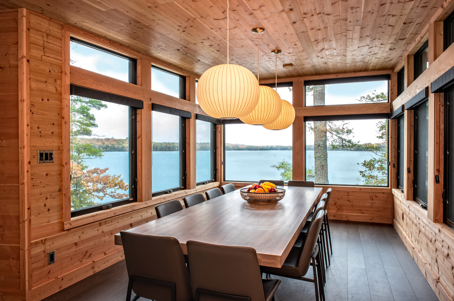 Dining room in prefabricated cottage with wrap around picture windows