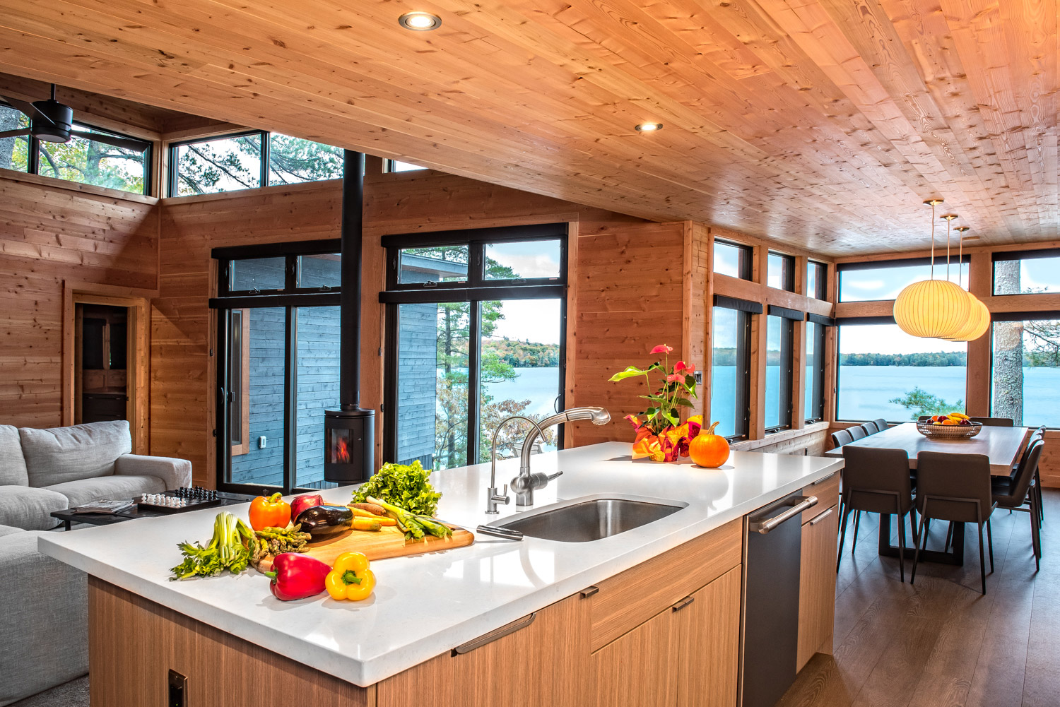 Kitchen dining room, and living room in pre-fabricated cottage with quartz countertops with undermounted sink