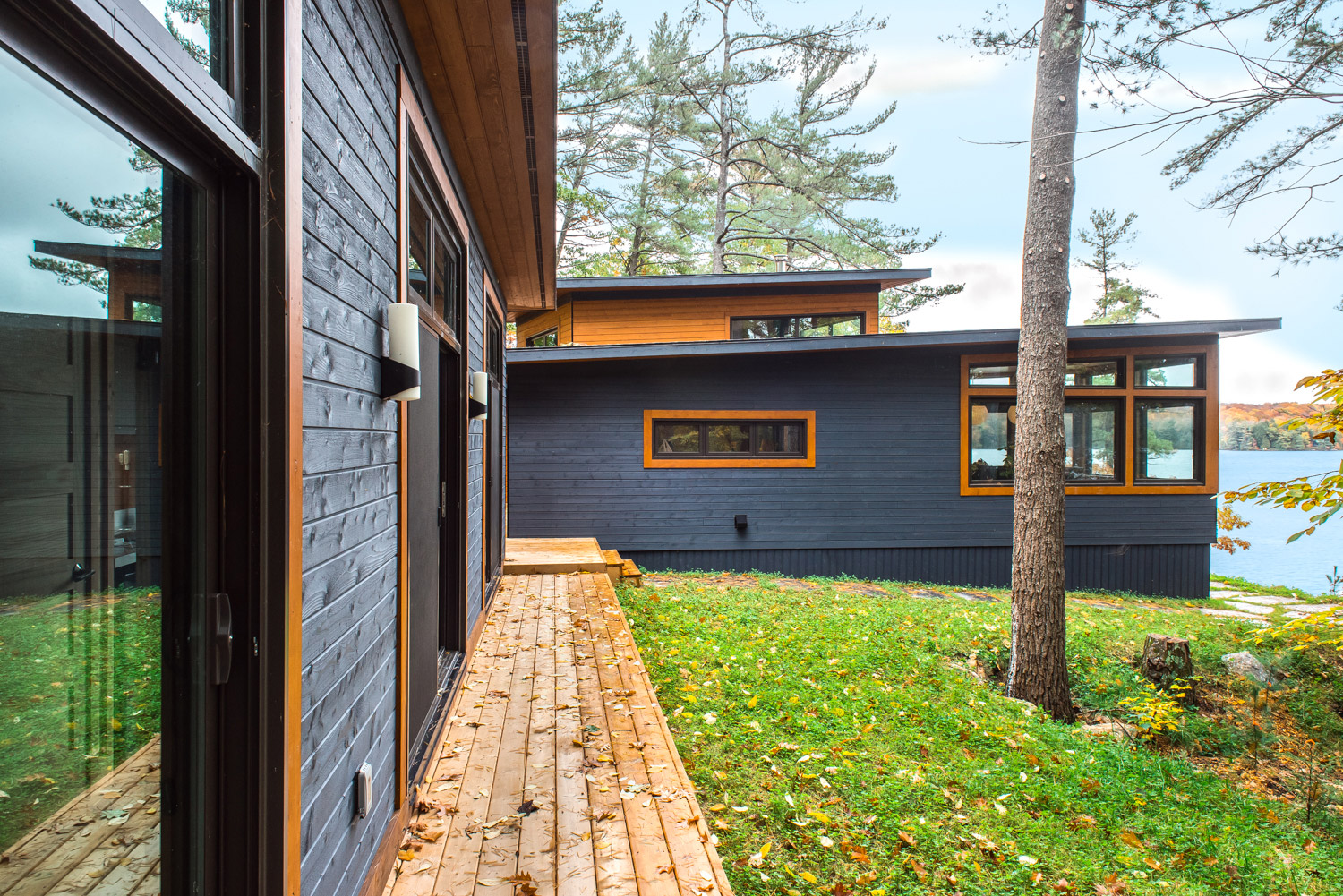 Ontario cottage with integrated bunkie, and decking with close proximity to lake