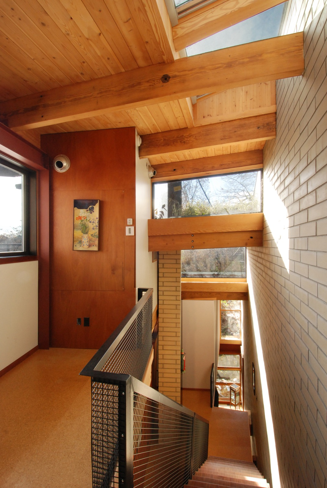 The staircase is open to the outdoors with clerestory windows revealing the Green Roof